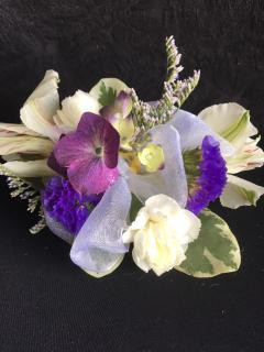 Purple and white wrist corsage